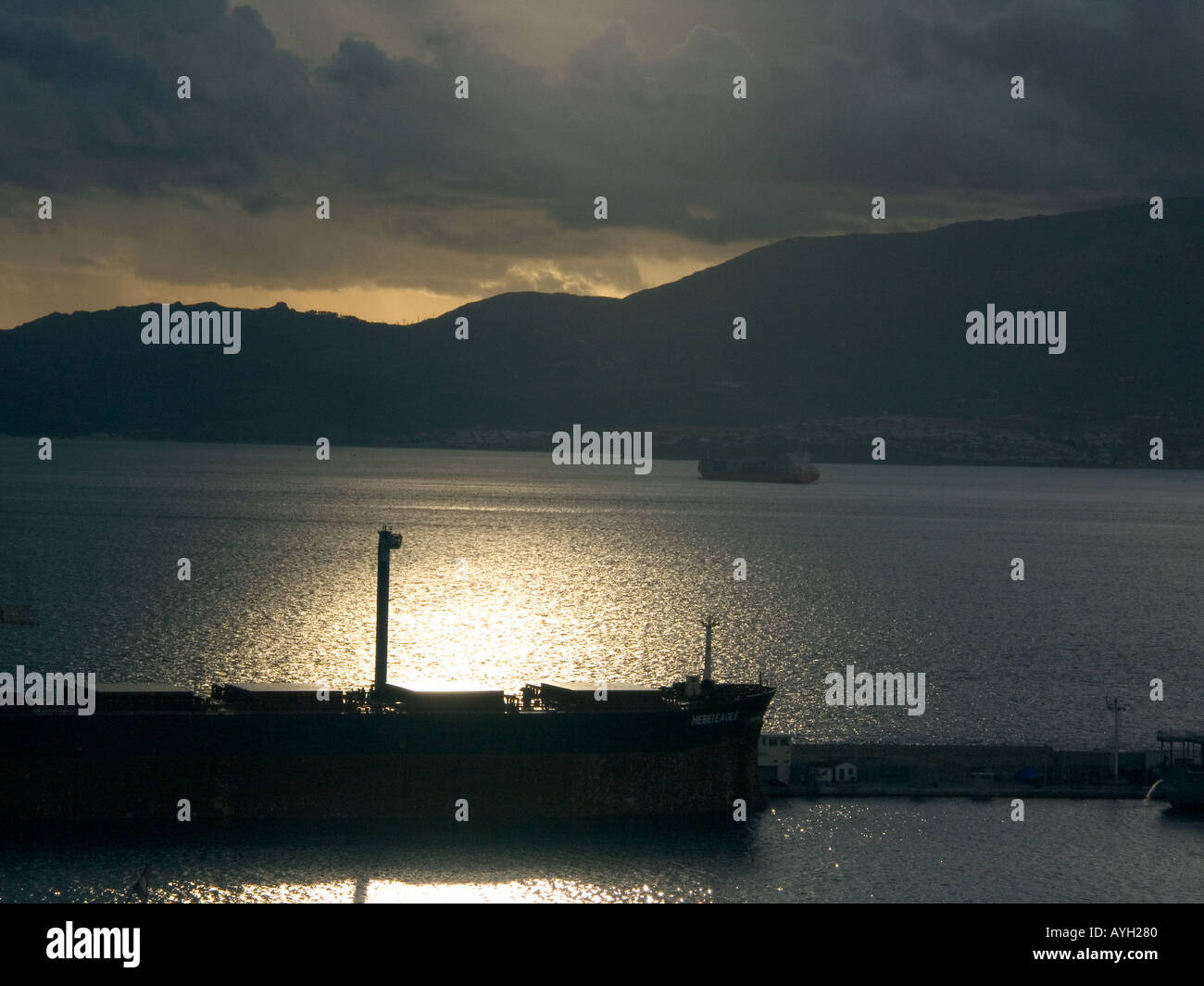 Sunset over The Bay of Gibraltar Shipyard, cloud, freight, ship, shipping, tanker, boat, shipyard, Gibraltarian, - Stock Image