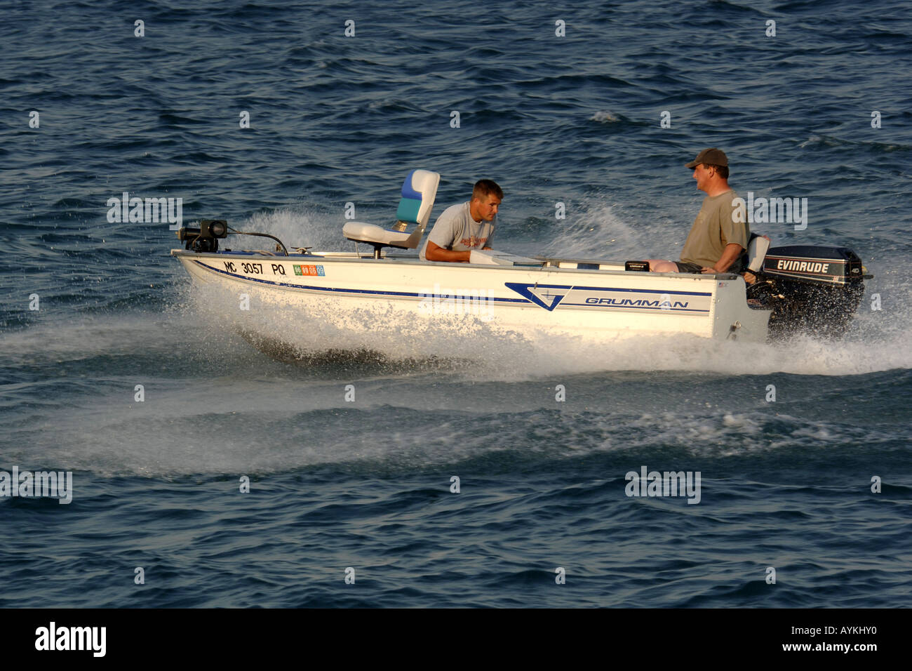 Small two man fishing boat with an outboard motor on the for Two man fishing boat