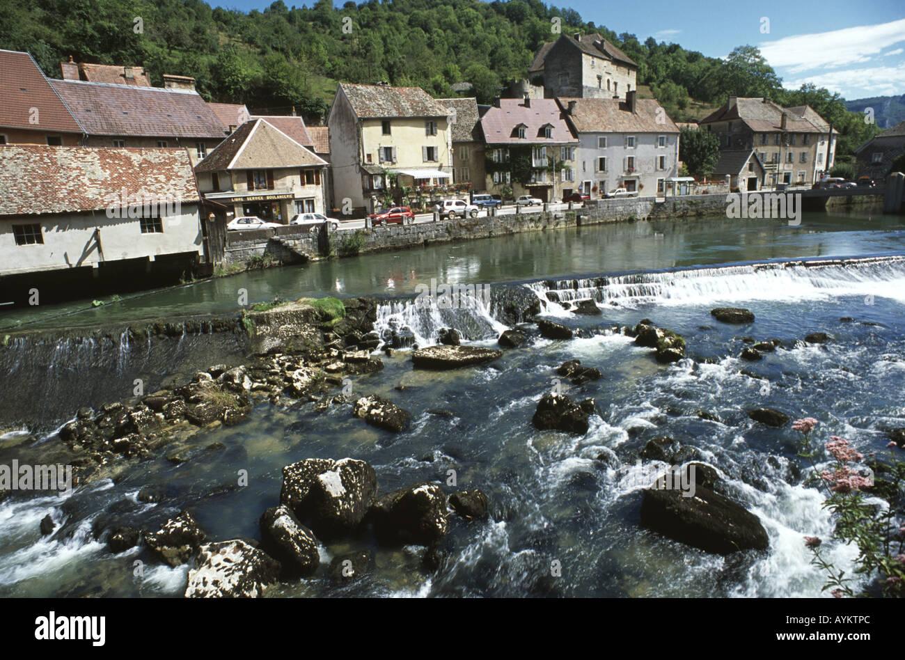 Pretty riverside village of Lods, Doubs France. - Stock Image