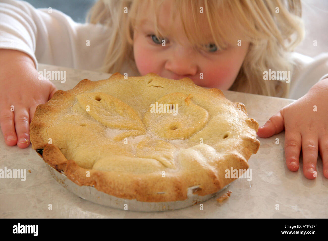young girl stealing apple pie - Stock Image