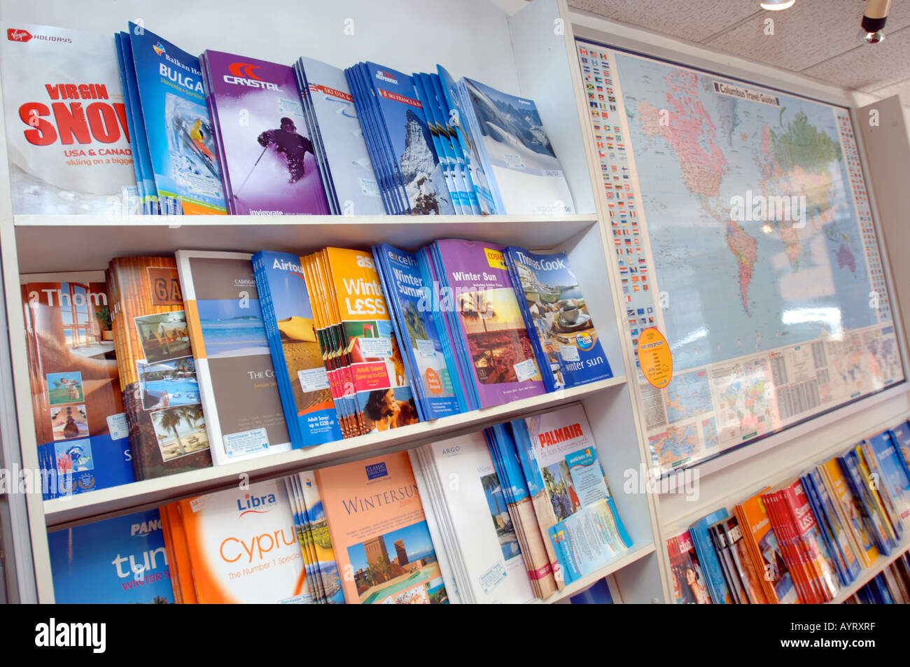 travel brochures on display at travel agency britain uk stock photo
