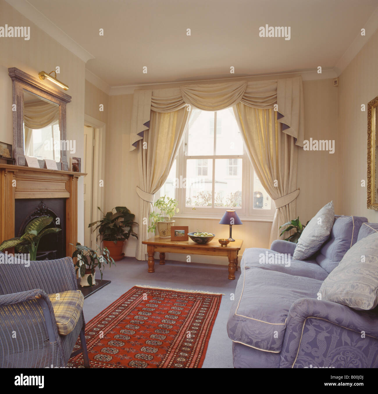 cream curtains for living room swagged and tailed curtains in living room with 20781