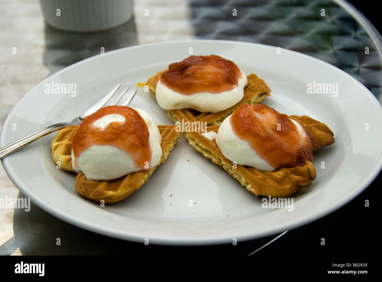 Waffles with cream and rhubarb preserve at the Debesarcafé, in the village of Gjógv, Faroe Islands Stock Photo
