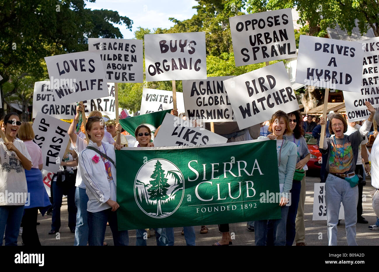 Rally promoting the Sierra Club, with women holding banners promoting environmental issues such as hybrid cars and - Stock Image