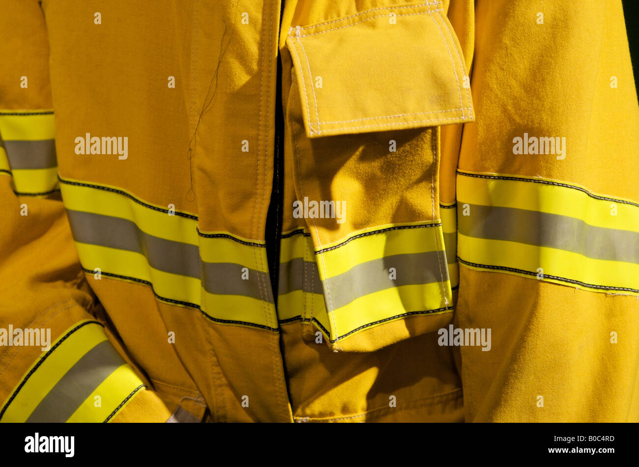 Close up view of reflective strip on a Nomex wildland figherfigher's jacket. - Stock Image