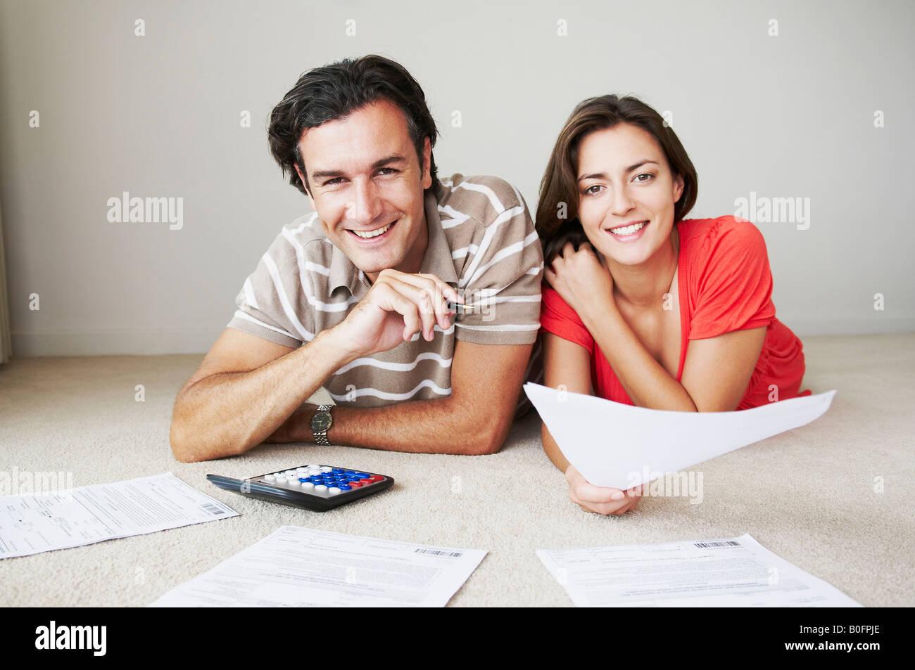Couple work on home finance - Stock Image