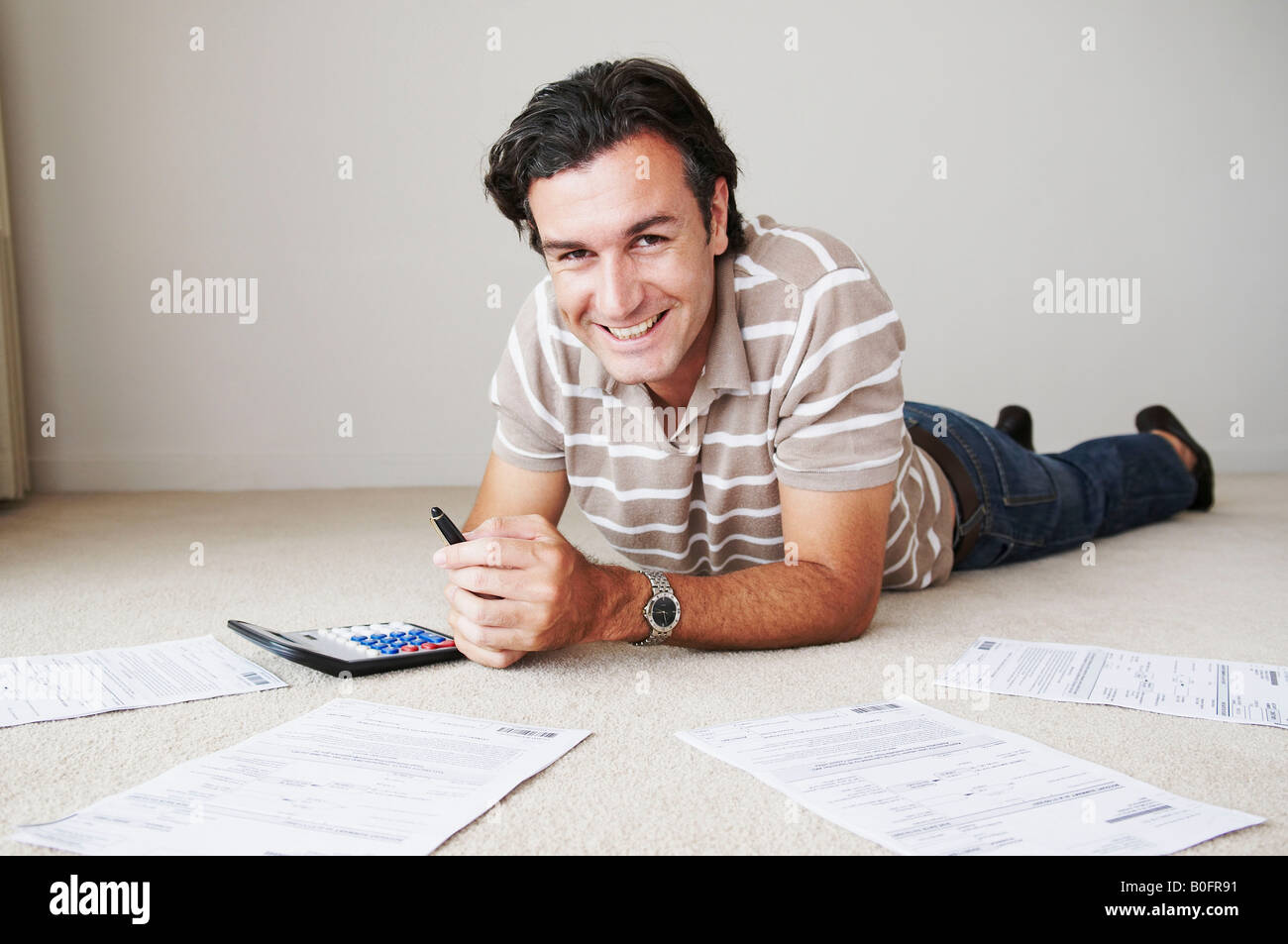 Man works on home finance - Stock Image