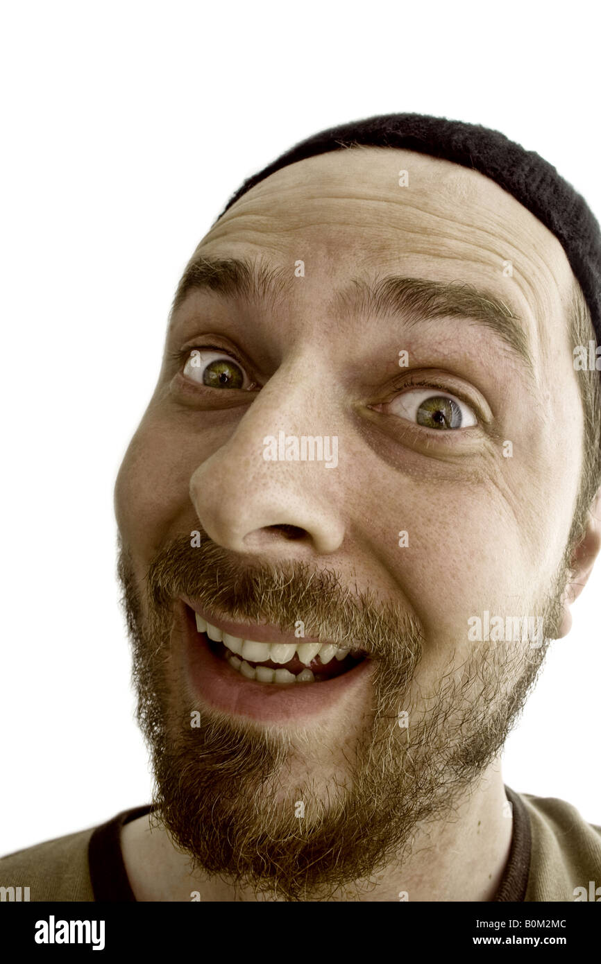 Crazy silly joking guy making funny face expression - Stock Image