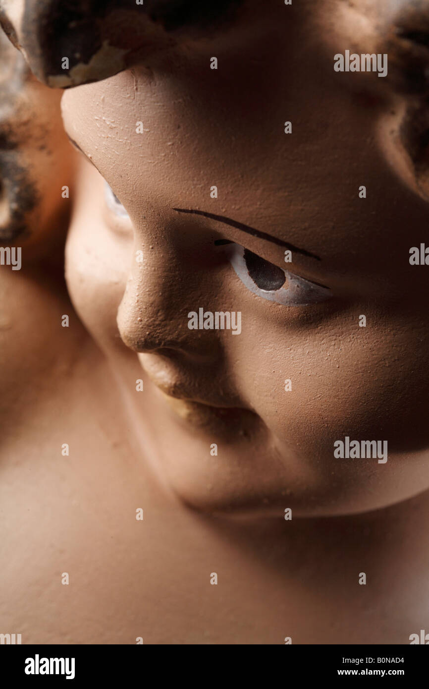 face of a kitsch plastic statue - Stock Image