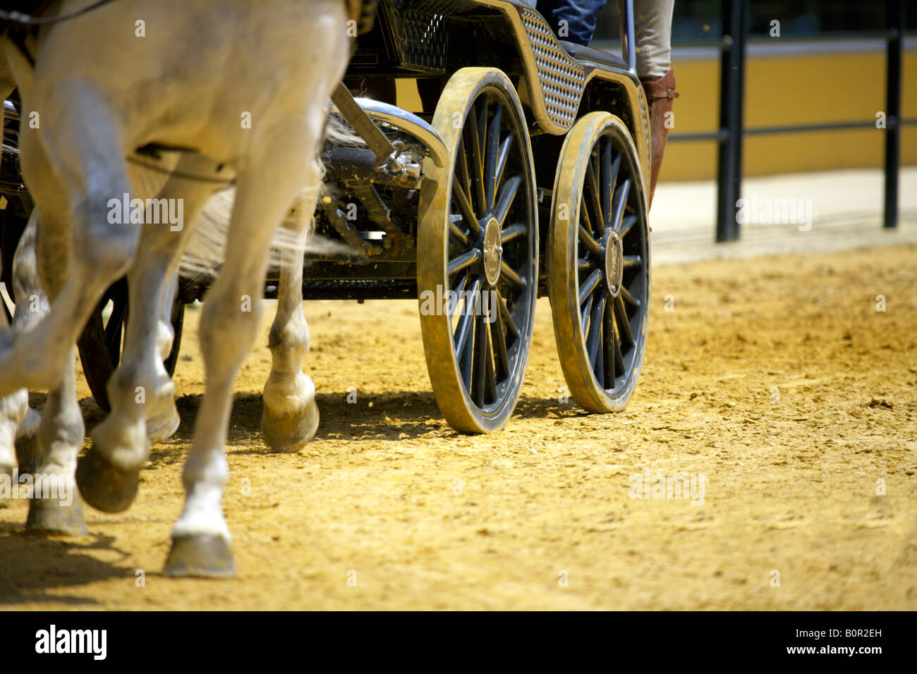 Wheels and hooves of a horse drawn chariot, Jerez de la Frontera, Andalucia, Spain - Stock Image