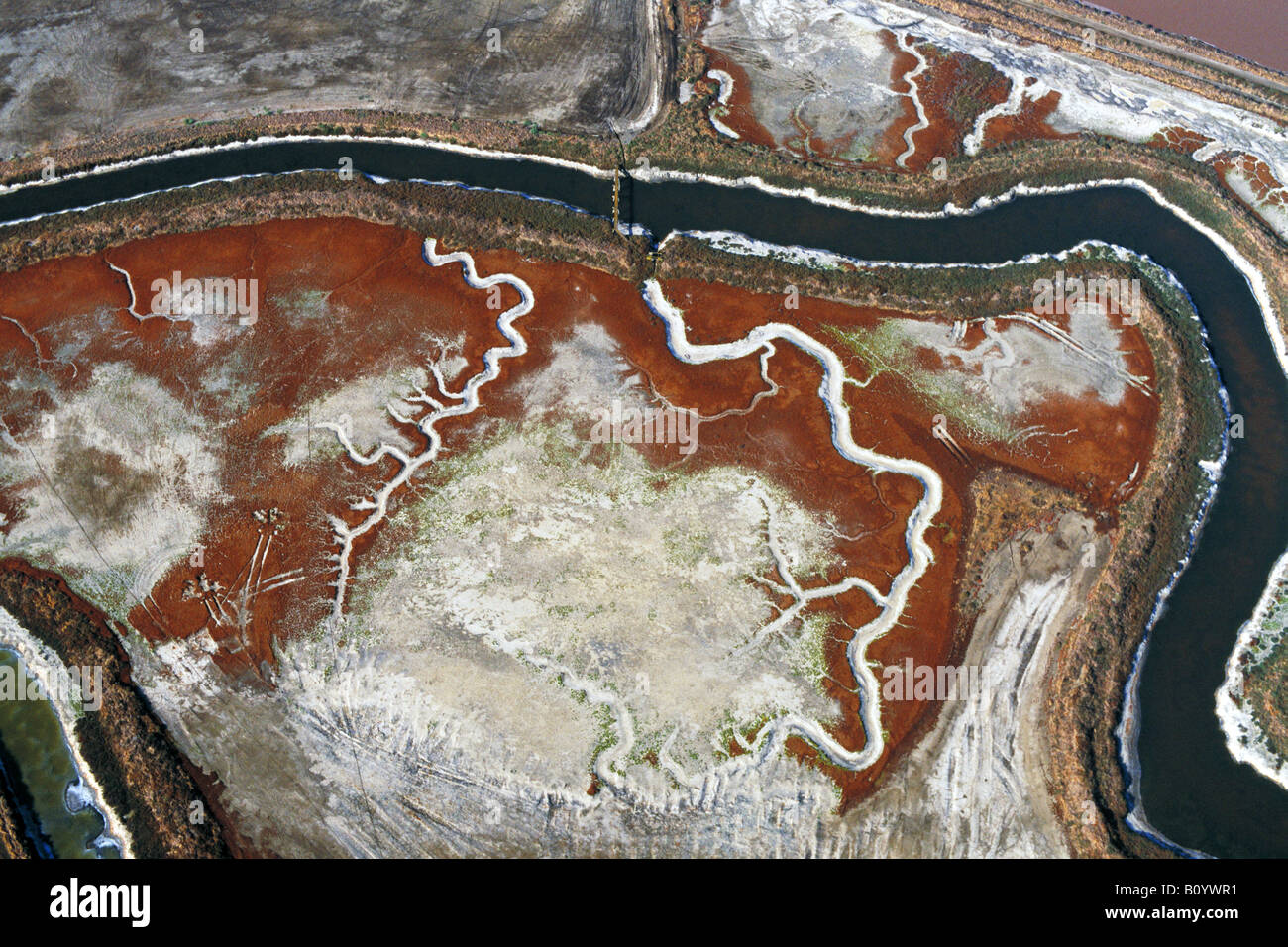 aerial above salt crystallizer following ancient tidal channels San Francisco bay - Stock Image