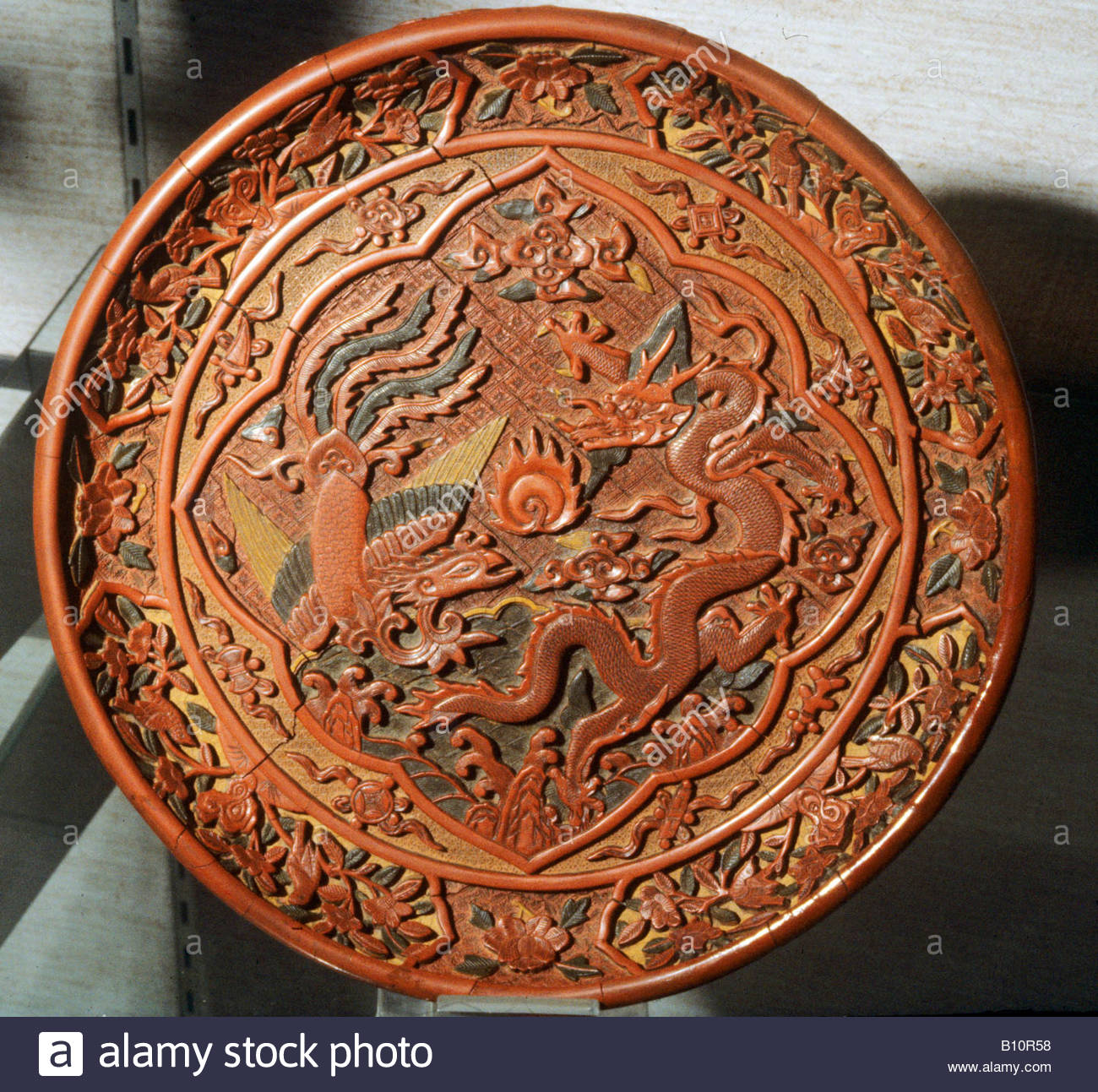 Ming Dynasty laquered dish with dragon and phoenix 15th c China AAAC Ltd Stock Photo