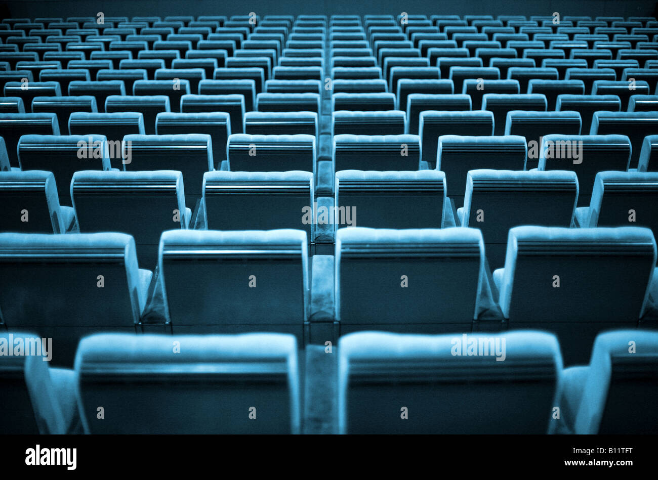 Empty chairs at cinema or theater. Blue tone. - Stock Image