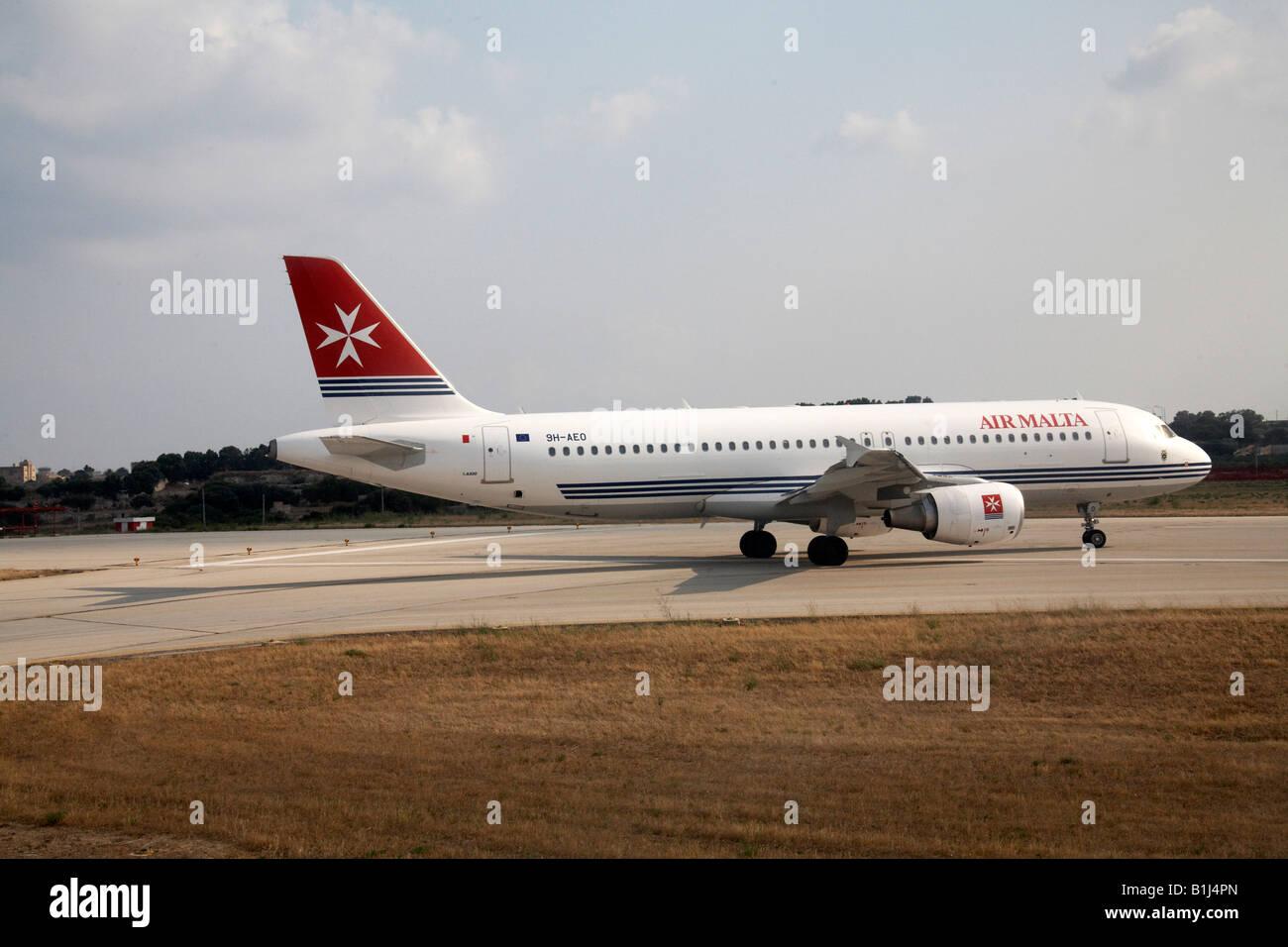 Air Malta Airbus A320 214 aircraft taxiing on taxiway at Malta International Airport - Stock Image