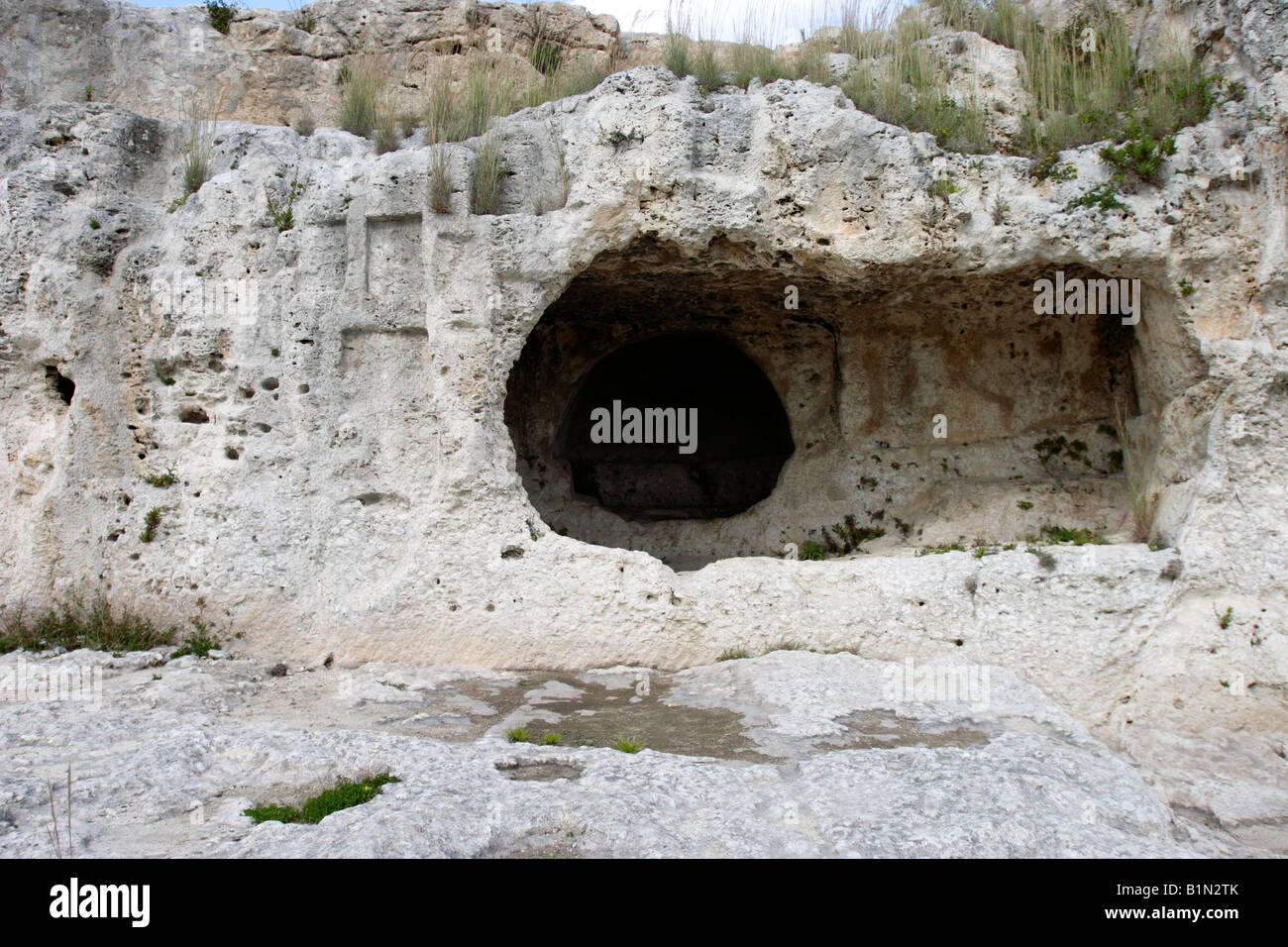 a niche cut into the rock above the ancient greek theatre in