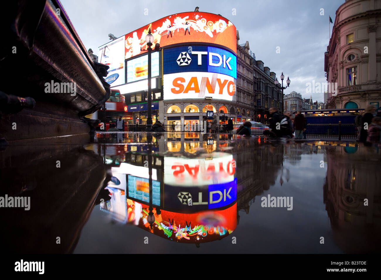 Buildings reflect in the puddles after the rain at Piccadilly Circus. Stock Photo
