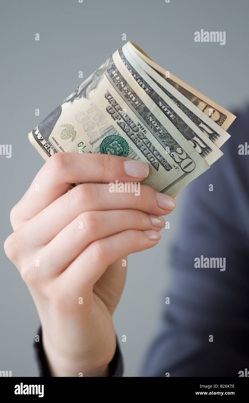 Money in woman's hand - Stock Image