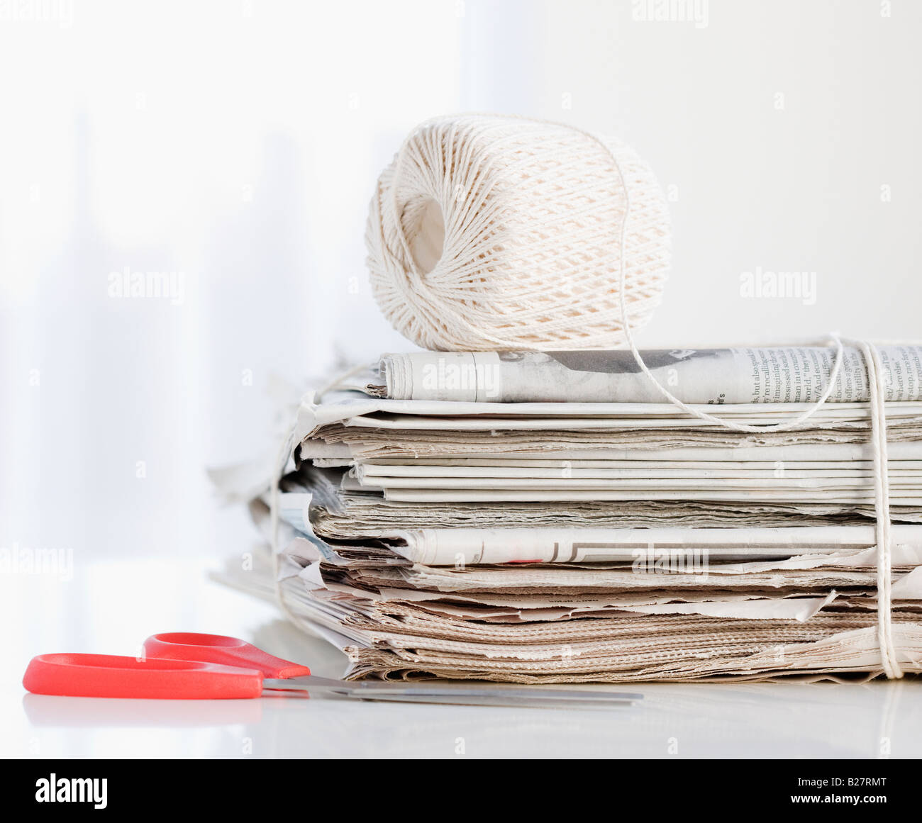 String and scissors with newspaper bundle - Stock Image
