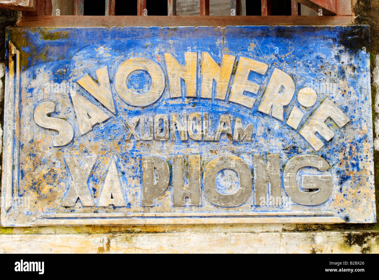 Old french advertising sign from a perfumerie, Hoi An, UNESCO World Heritage Site, Vietnam, Asia - Stock Image