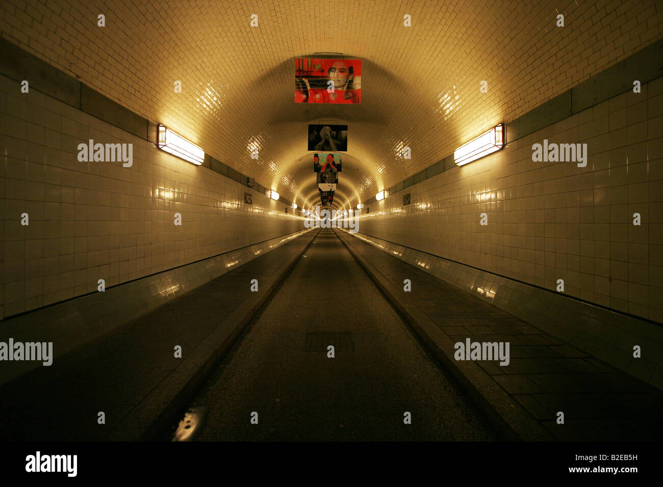 Fluorescent lights lit up on wall in tunnel, Old Elbe Tunnel Stock ...