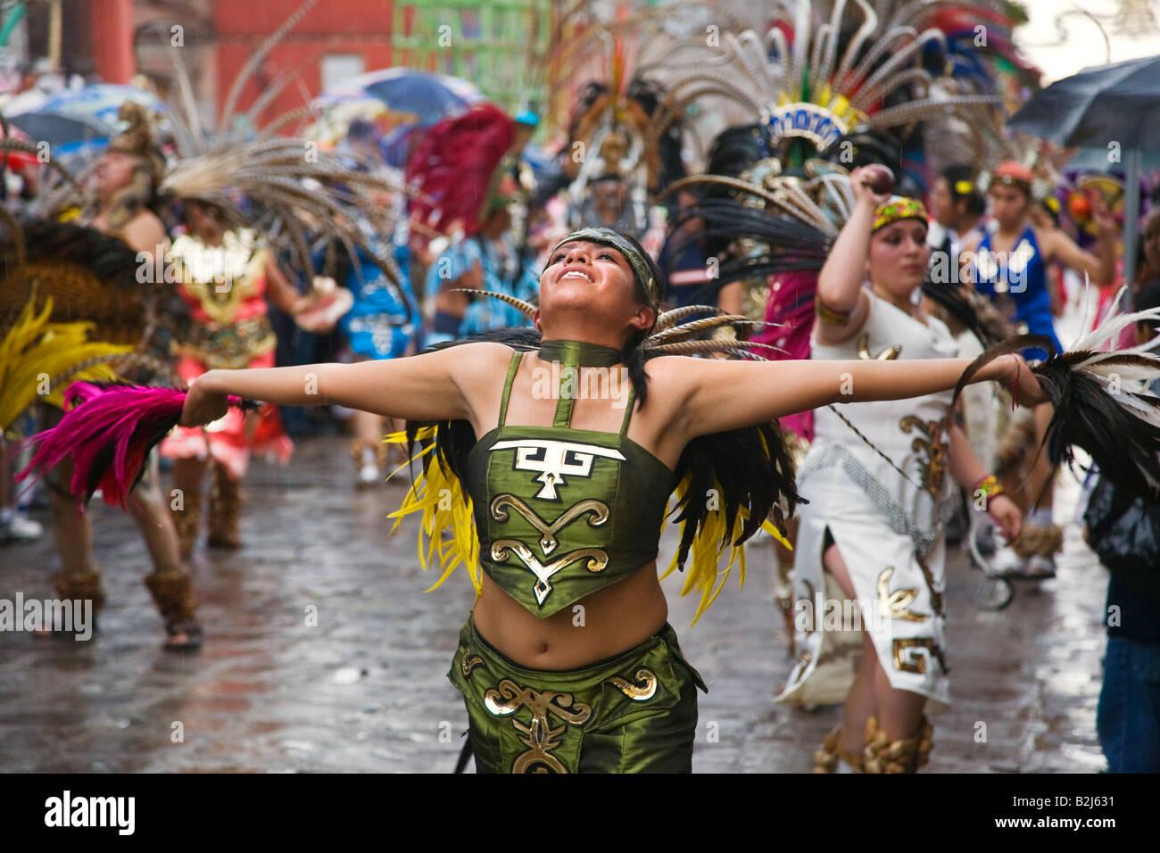 mexican women dance in aztec indian costumes in the festival de san