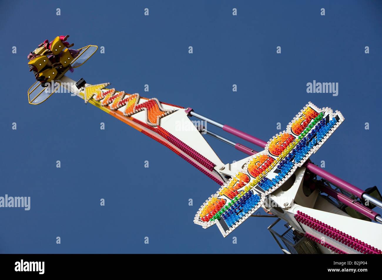 UK England Manchester Platt Fields Mega Mela Speed Buzz rotating white knuckle fairground ride - Stock Image