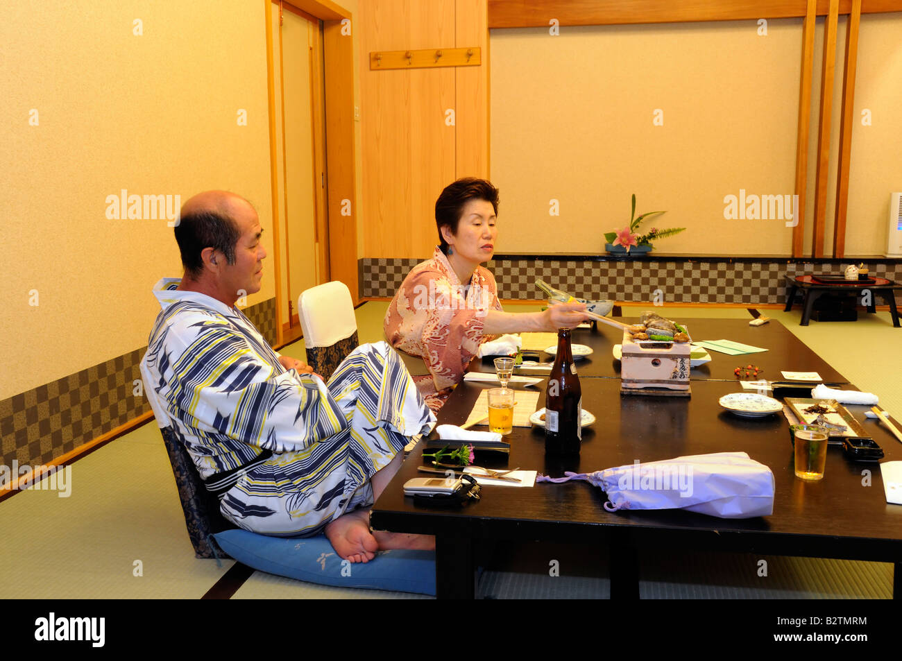 Senior couple in kimono, yukata at Ryokan which is japanese style hotel, Japan Stock Photo