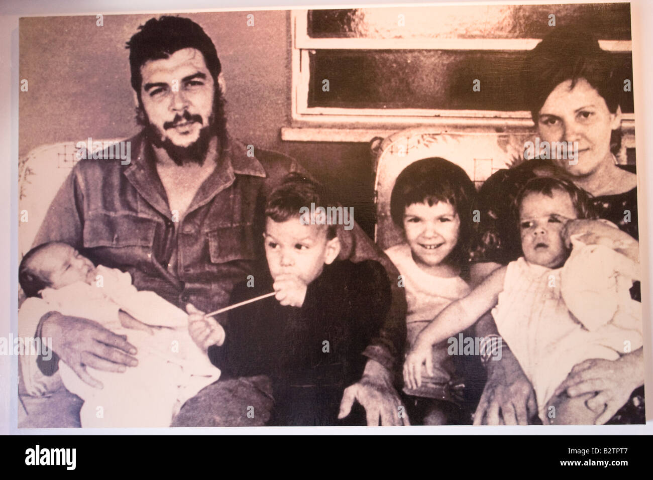 Photo of Ernesto Che Guevara with his wife Aleida March and their children exhibited in the Museum in Alta Gracia, Stock Photo