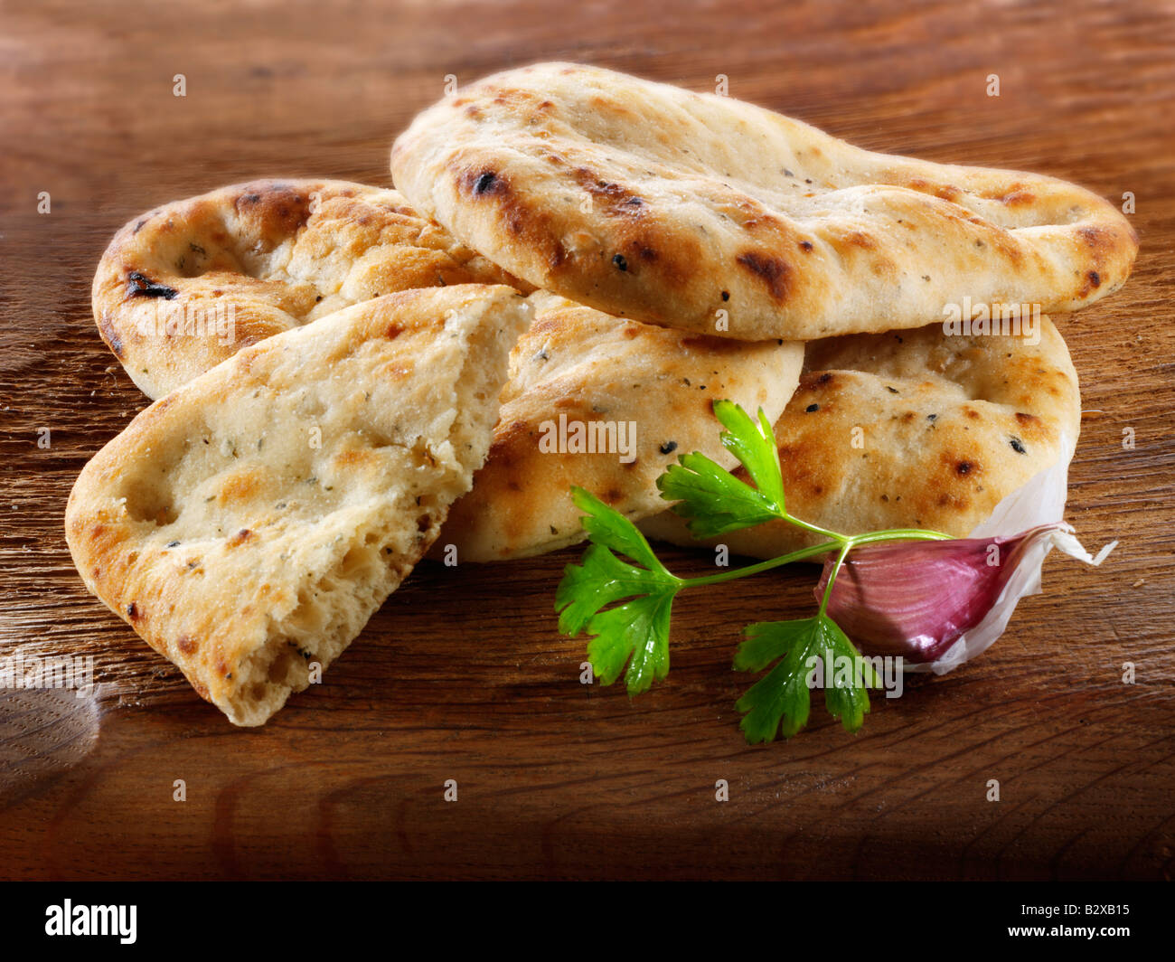 Garlic and coriander Indian Naan Bread - Stock Image