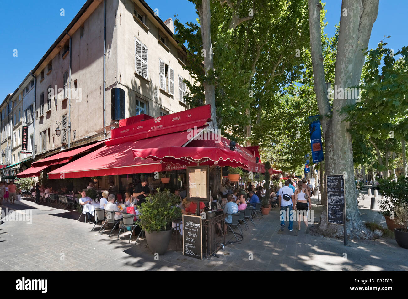 Street cafe on the Cours Mirabeau in the historic city centre Aix en Provence France - Stock Image