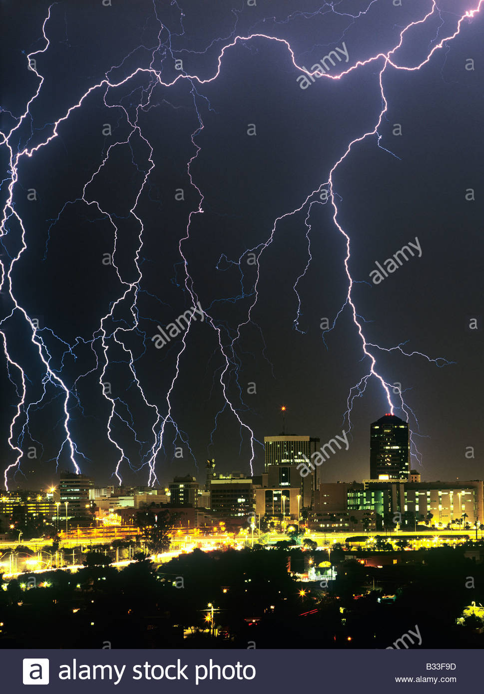 Lightning Storm, Thunderstorm Over Downtown Tucson Arizona USA With Large  Lighting Bolts In The City.