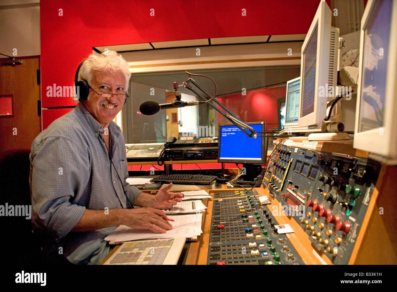 Bill Heine The Silver Fox broadcaster and presenter BBC Radio Oxford in the studio at the controls PER0133 - Stock Image