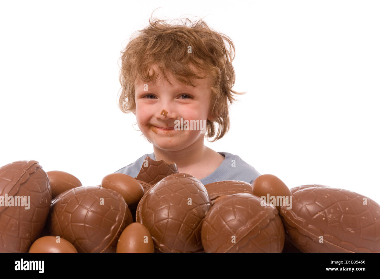Young Boy With Large Pile Of Easter Eggs