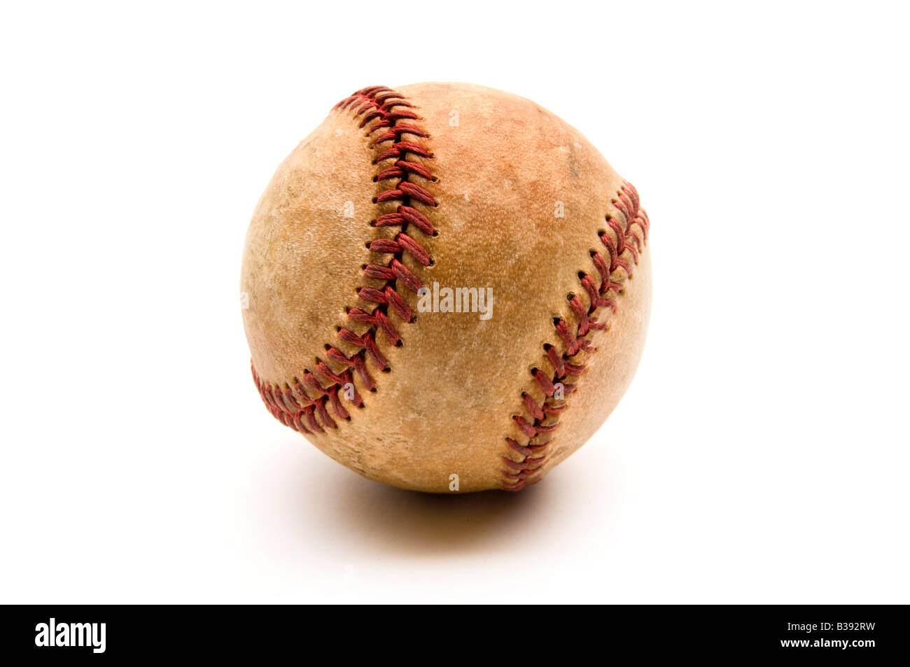 Old baseball on white with shadow - Stock Image