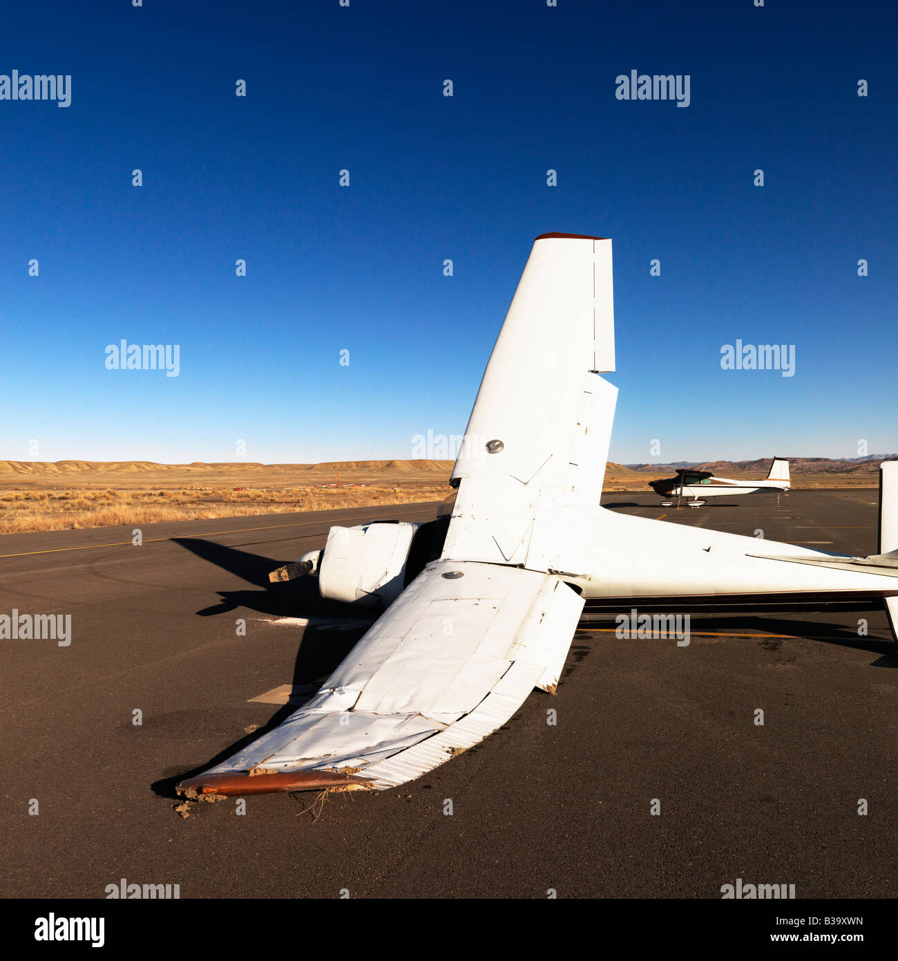 Crashed plane on tarmac at Canyonlands Field Airport Utah United States - Stock Image
