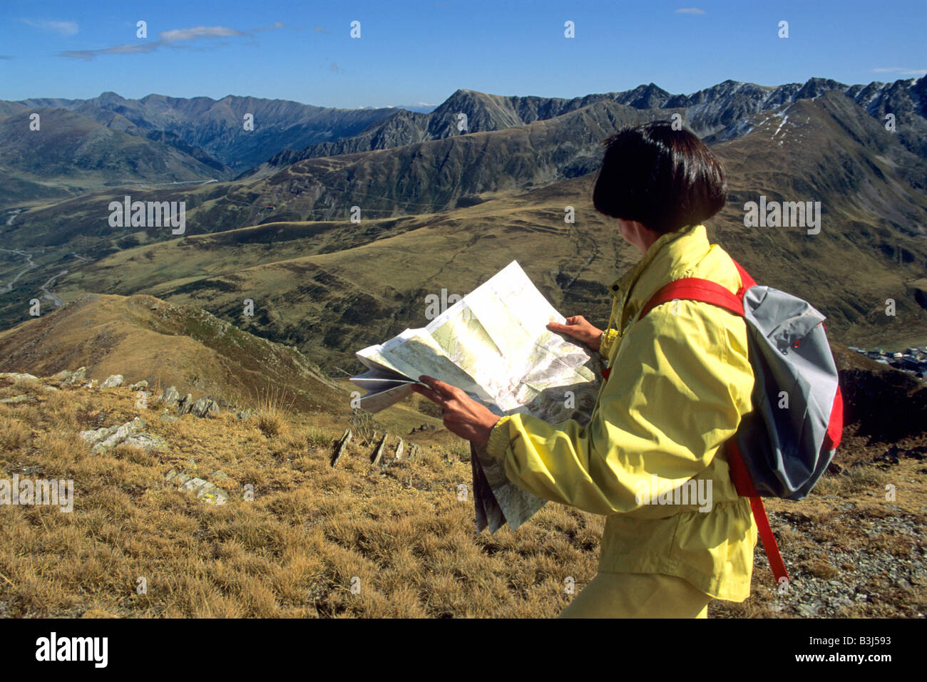 Hiker Woman Looking At Map In The Pyrenees France Europe Stock