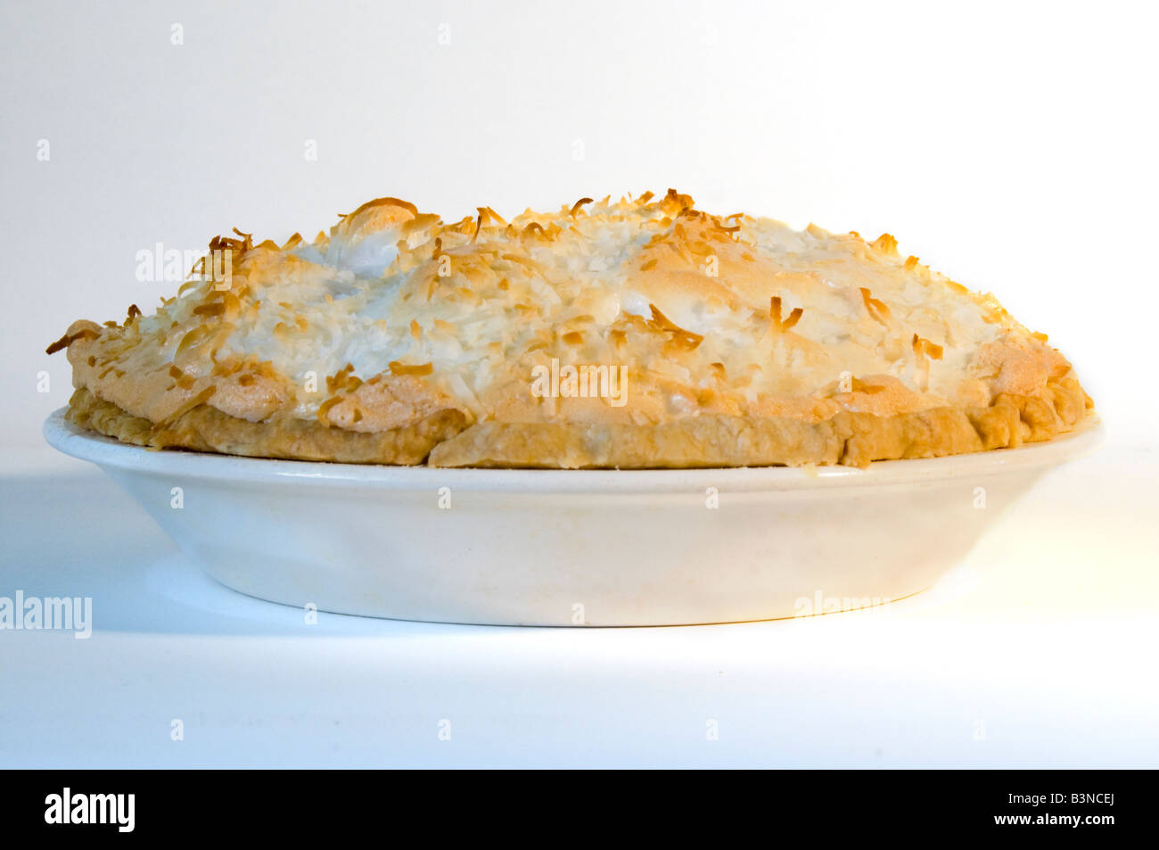 a-coconut-cream-pie-on-a-white-backgroun