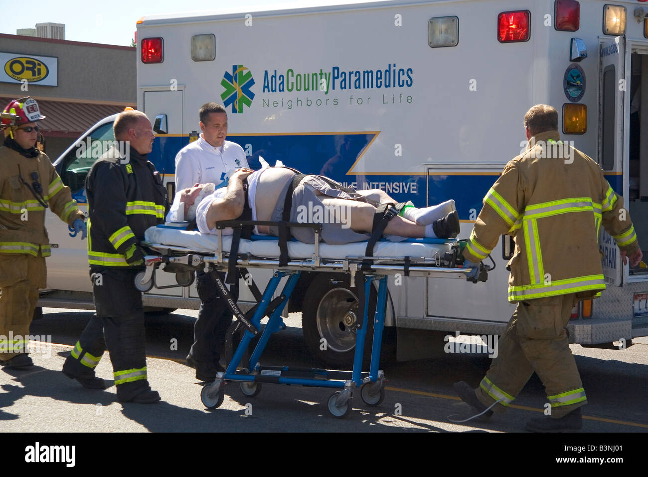 Traffic accident victim being transfered to an ambulance in Boise Idaho - Stock Image