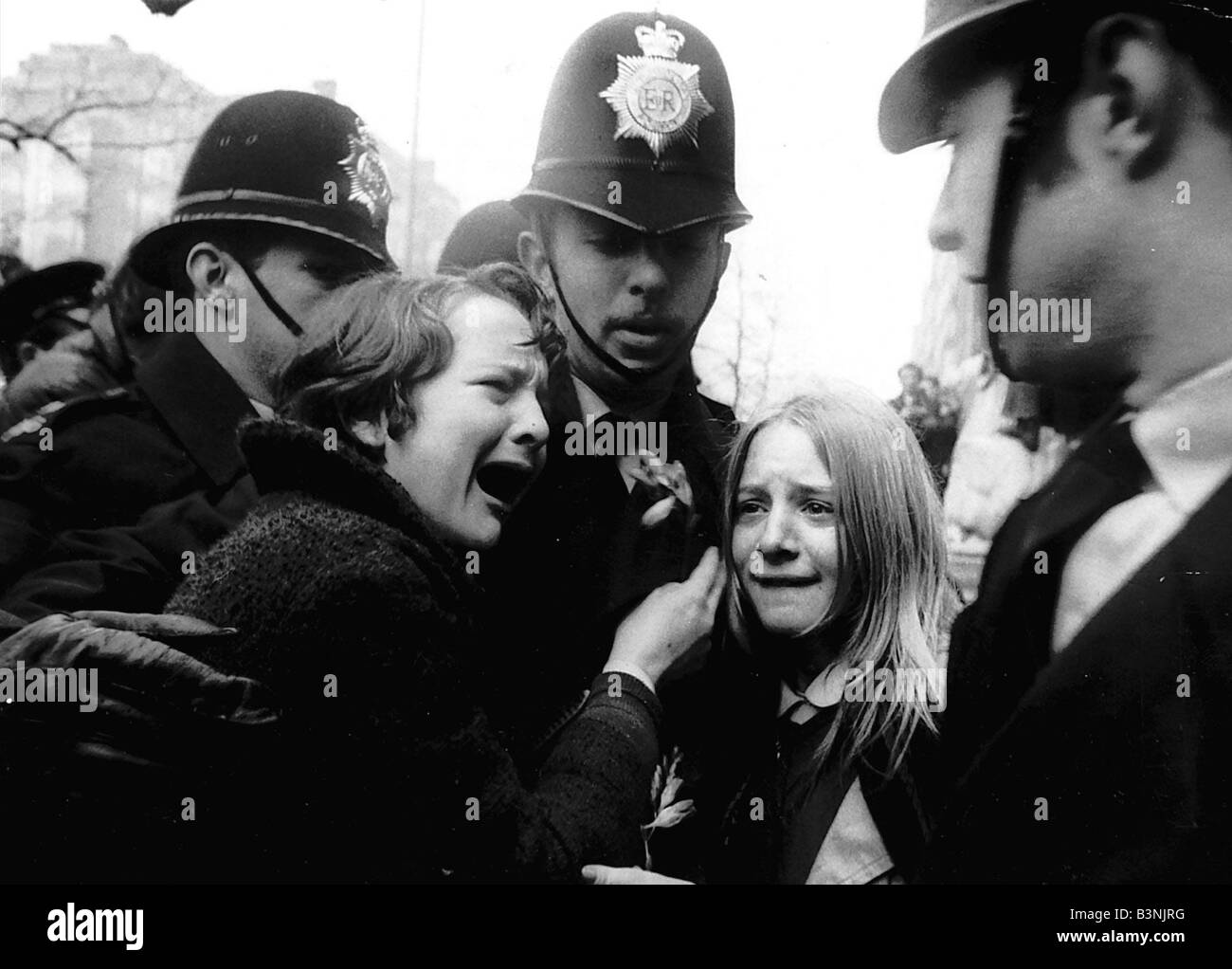 Upset Beatles fans crying because Paul McCartney got married are led away by police March 1969 Stock Photo