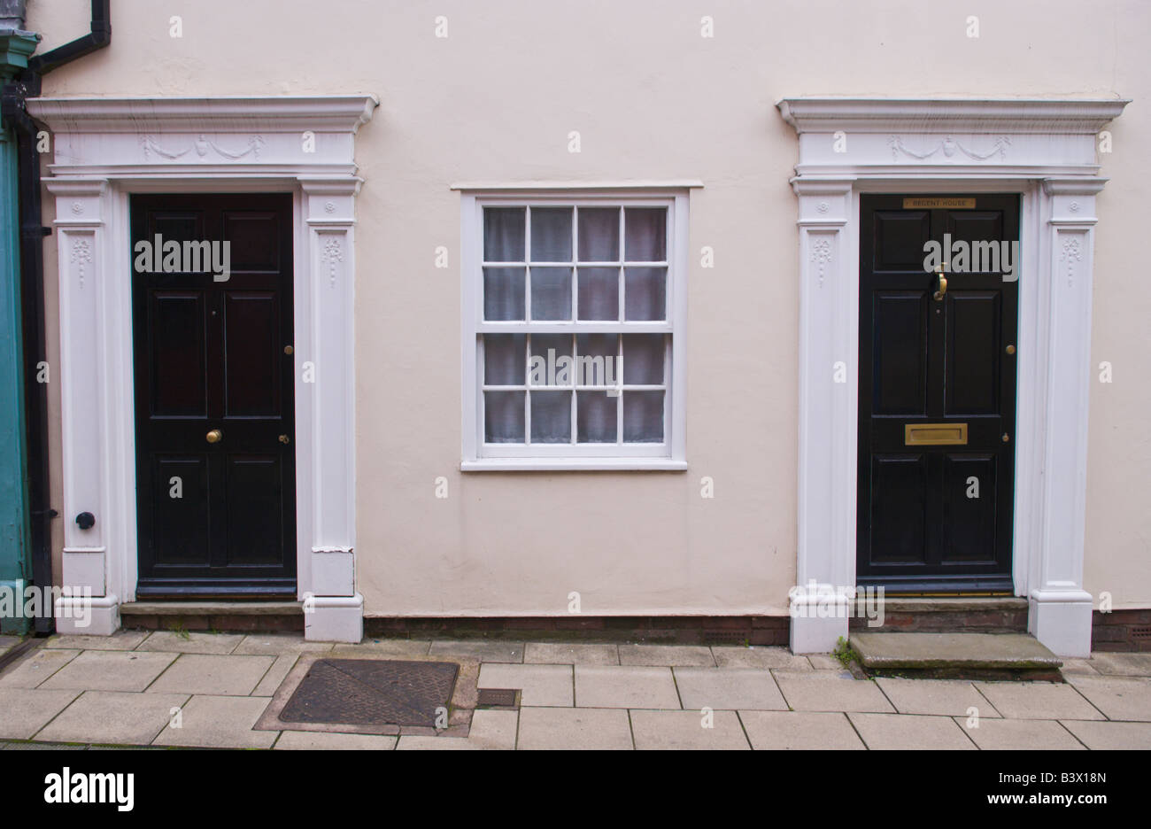 Black Front Doors With White Architrave And Sash Windows Between Of