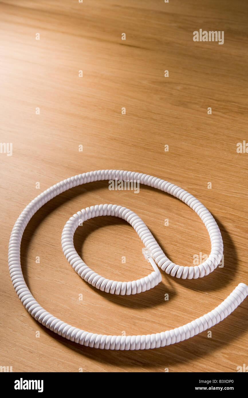 Telephone Cord Making 'At' Symbol - Stock Image