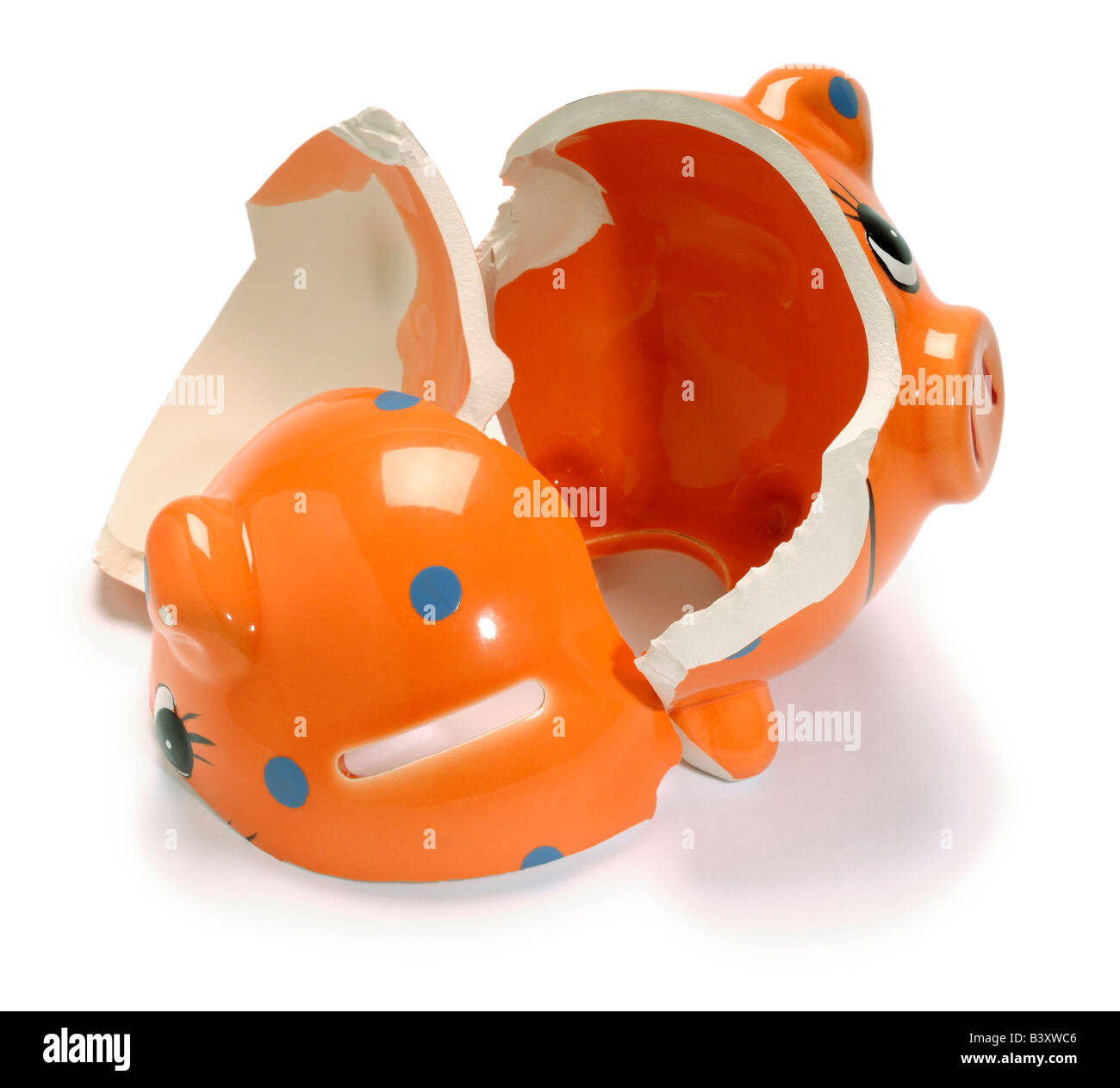 Broken smashed piggy bank - Stock Image