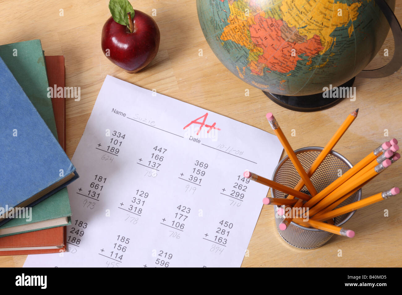 school education still life with books globe apple pencils and a