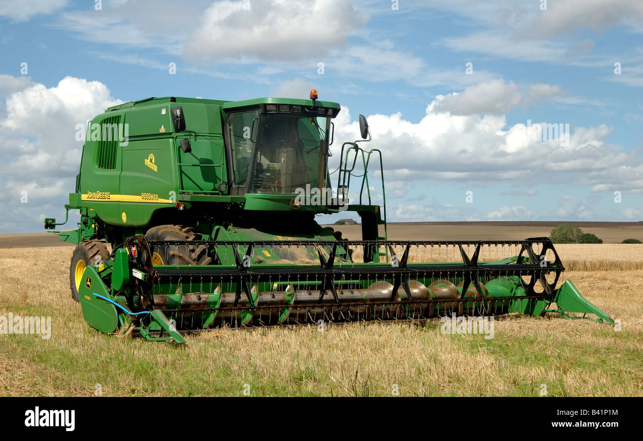 Combine harvester standing in field havig finished cutting crop - Stock Image