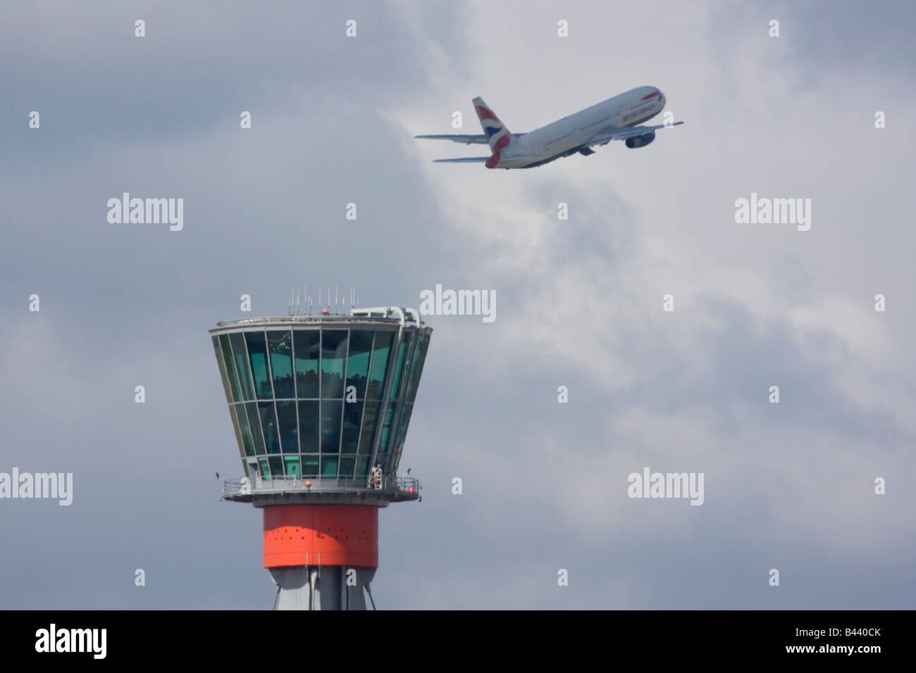 Northwest Airlines Airbus A330 taking off in the background of London Heathrow control tower. - Stock Image