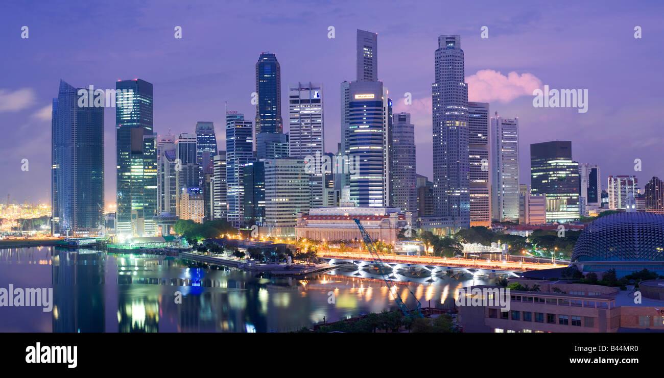 Asia Singapore Singapore Skyline Financial district at dusk - Stock Image