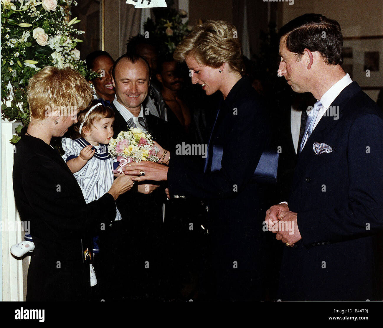Phil Collins And His Family Meet Prince Charles Princess Diana Of Wales At The Royal Albert Hall
