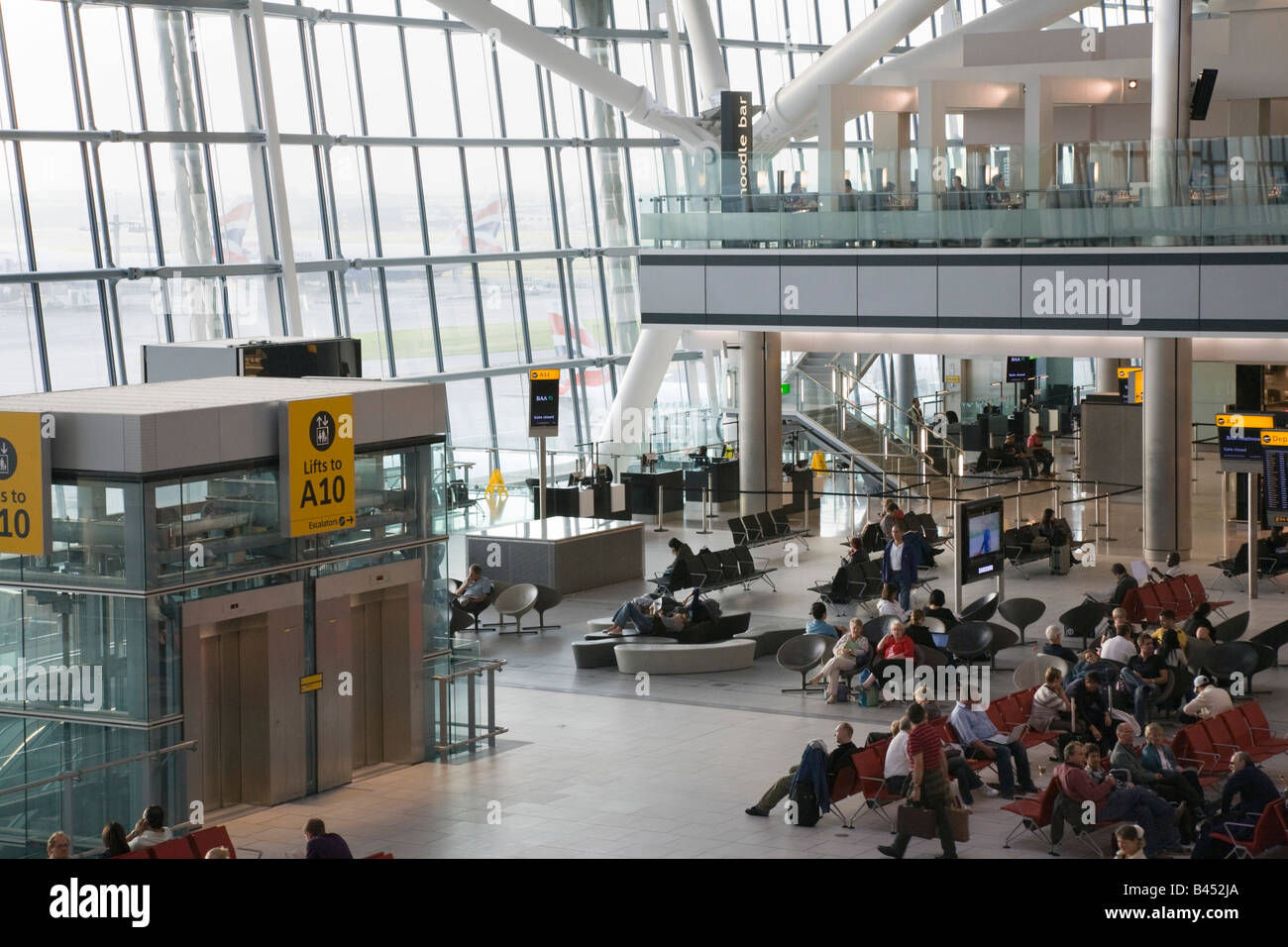 People in London's Heathrow Airport British Airways departures lounge inside Terminal 5 building England UK - Stock Image