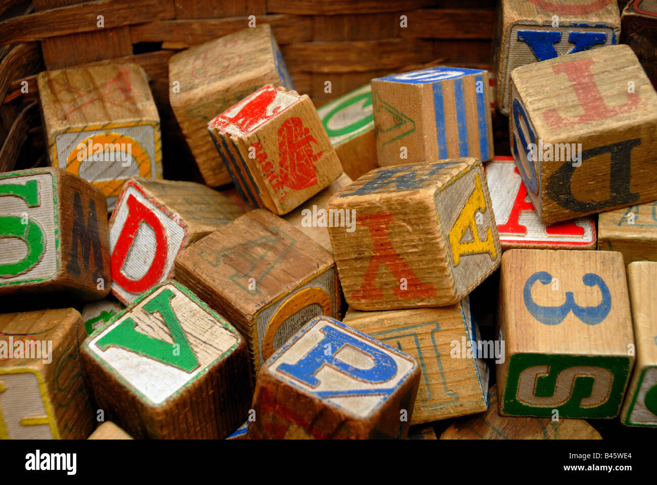 Vintage wooden blocks with colorful letters and numbers on them, in an antique store. Stock Photo