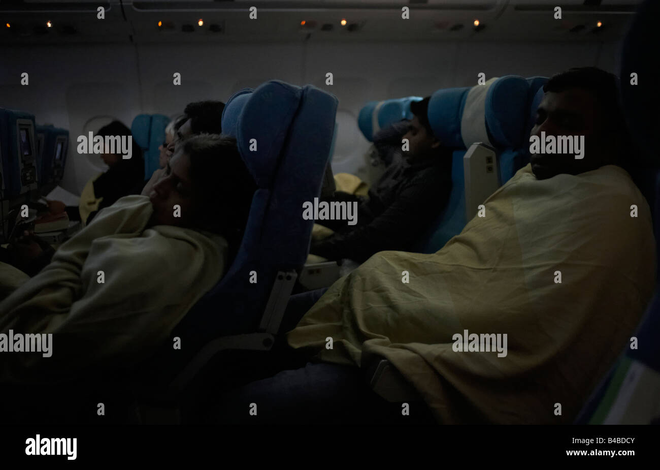 with-cabin-lights-dimmed-economy-class-p